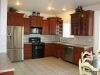 Kitchen with staggered cabinets, tile flooring, stainless appliances