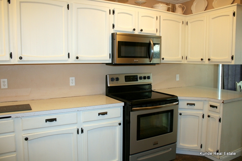 Ktichen with stainless appliances and refinished cabinets