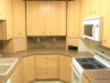 Kitchen includes dishwasher, range, microwave, refrigerator.