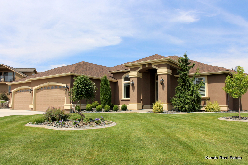 This Stunning Summit View Rambler Features A 4 Car Garage, 3 Bedrooms,  Office/den, 2.5 Bathrooms, And A Half Acre Lot.