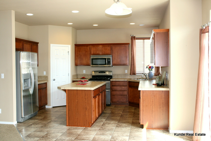 Kitchen with stainless appliances, double ovens, & fridge!